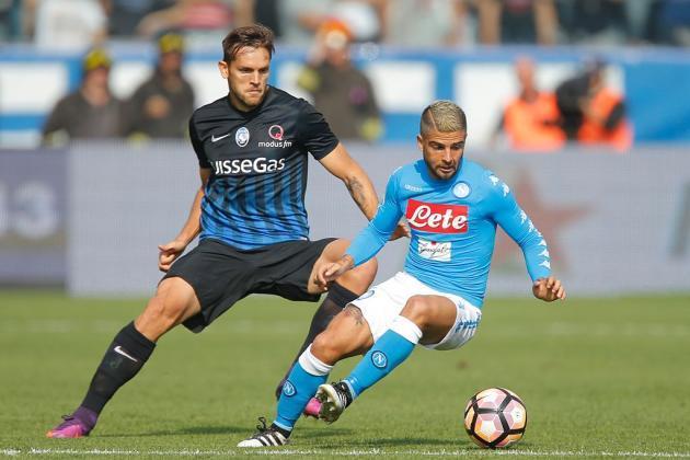 Napoli forward Lorenzo Insigne tries dribbling past Atalanta defender Rafael Toloi. (Getty Images)