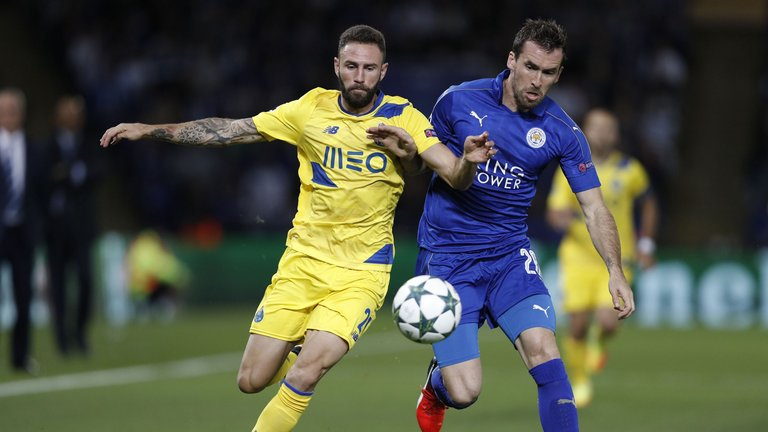 Christian Fuchs (right) playing for Leicester City.