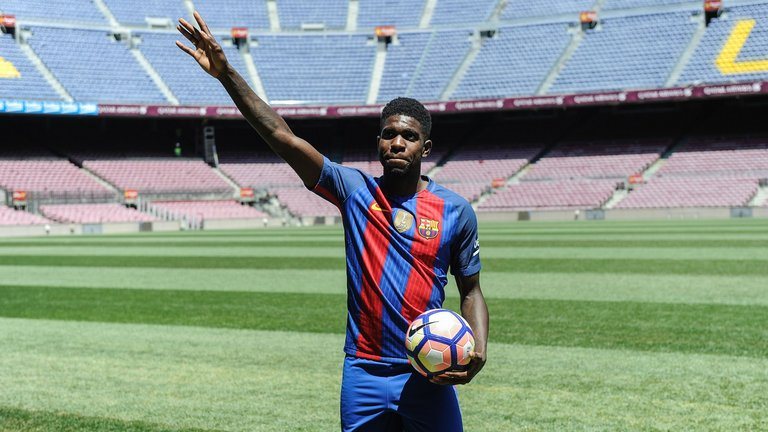 Umtiti while being unveiled as a new signing by Barcelona in 2016.