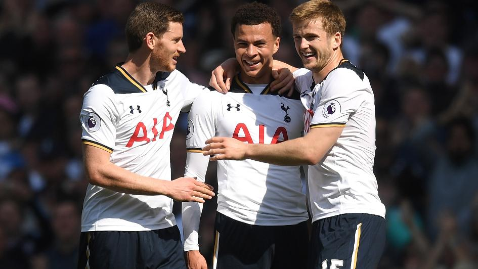 Eric Dier celebrates with his teammates after Tottenham scored a goal during a Premier League match.