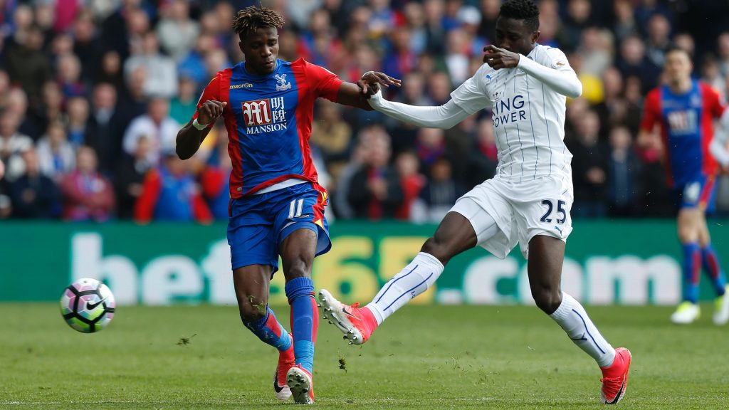 Ndidi (right) fights for the ball with Crystal Palace's Wilfred Zaha.