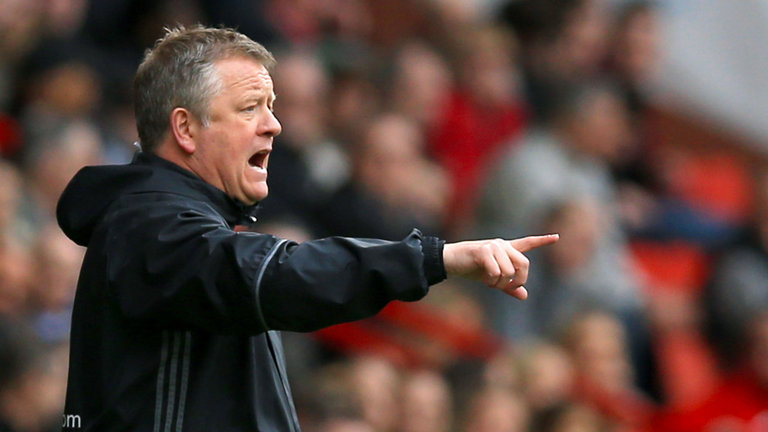 Sheffield United coach Chris Wilder gives instructions to his players during a match.