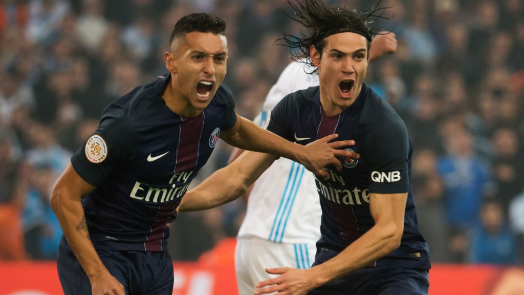 PSG teammates Marquinhos and Edinson Cavani celebrate a goal. (Getty Images)
