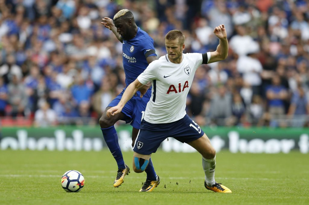Tottenham Hotspur midfielder Eric Dier engages in a tussle during a Premier League match against Chelsea.