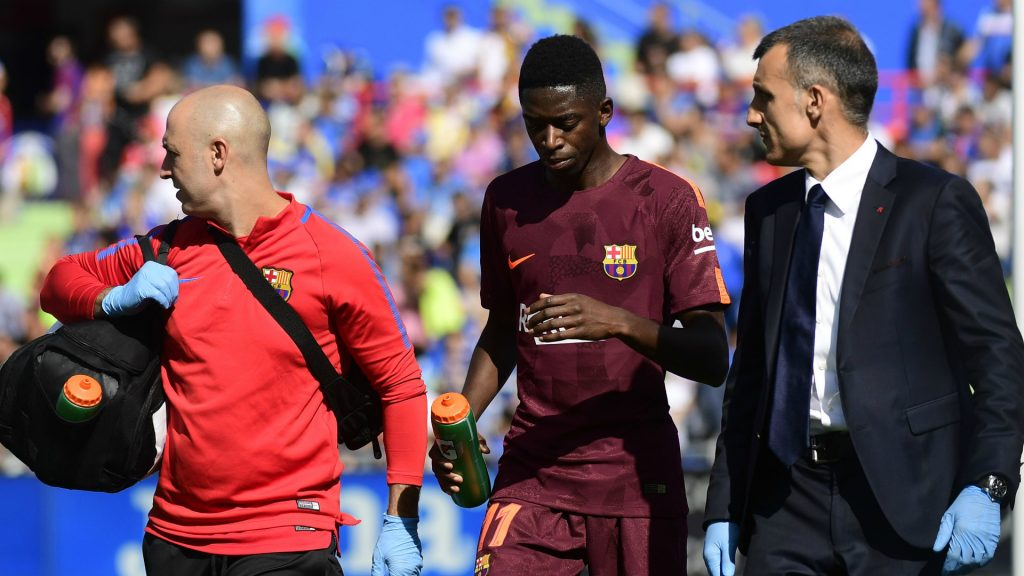 Barcelona's Ousmane Dembele being carried away by the medical staff after getting injured during a La Liga encounter.