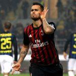 AC Milan's Suso celebrates after scoring against Inter Milan. (Getty Images)