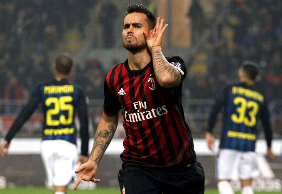 AC Milan's Suso celebrates after scoring against Inter Milan. (Getty Images)