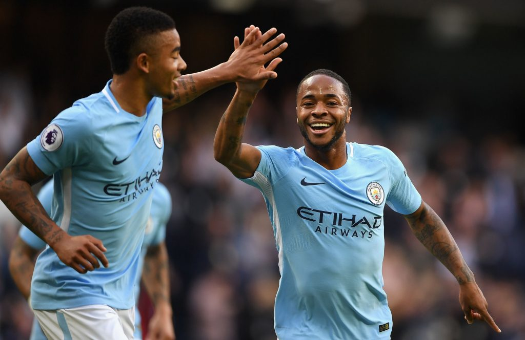 Manchester City forwards Gabriel Jesus (L) and Raheem Sterling (R) celebrate a goal. (Getty Images)