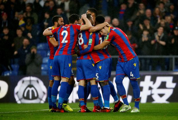 A jubilant Palace side celebrates a goal.