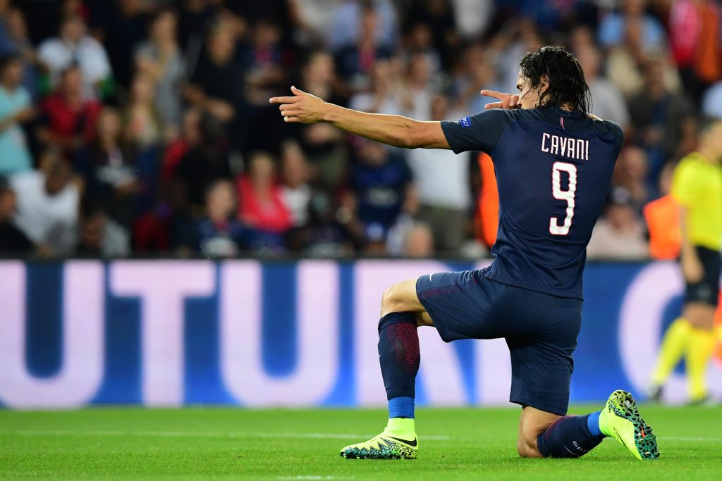 Edinson Cavani doing his trademark celebration after scoring a goal.