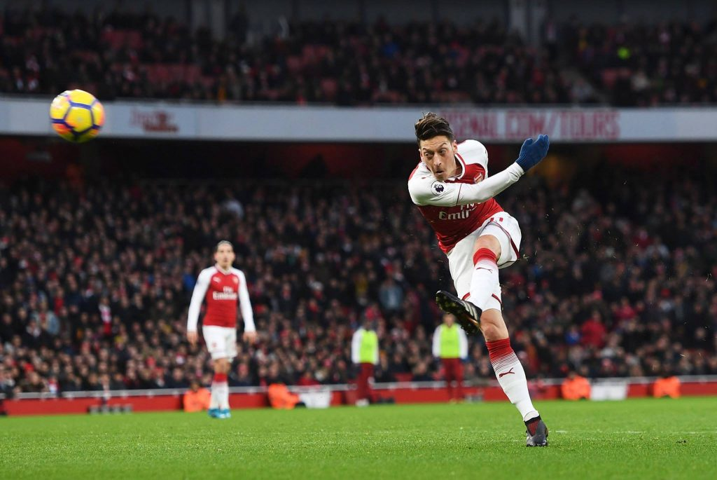 Mesut Ozil tries a shot from the distance.