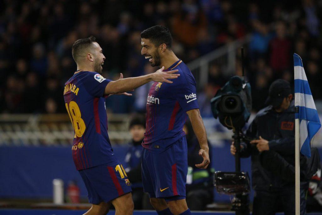 Barcelona's Jordi Alba and Luis Suarez celebrating a goal.