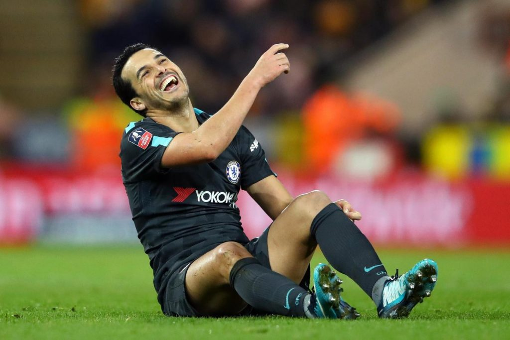 Chelsea's Pedro sharing a light moment on the pitch.