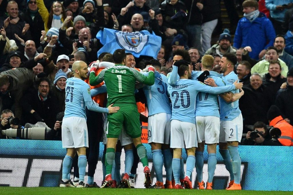 Manchester City players celebrating after a goal (Getty Images)