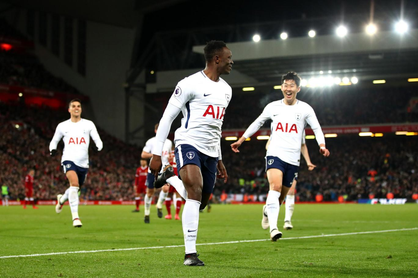 Victor Wanyama celebrates with his Tottenham teammates after scoring against Liverpool at Anfield. (Getty Images)