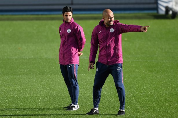 Arteta alongside Pep Guardiola.