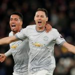 Manchester United's Nemanja Matic celebrates with Chris Smalling after scoring the winner against Crystal Palace. (Getty Images)
