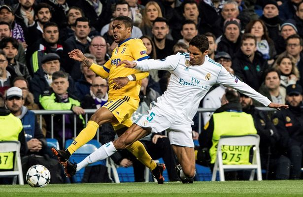 Varane engages in a tussle with Juventus winger Diego Costa.