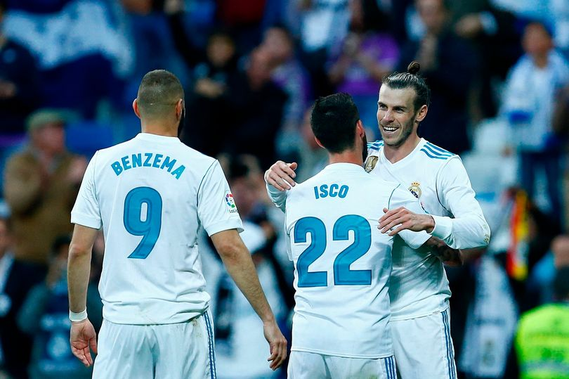 Real Madrid players celebrating a goal.