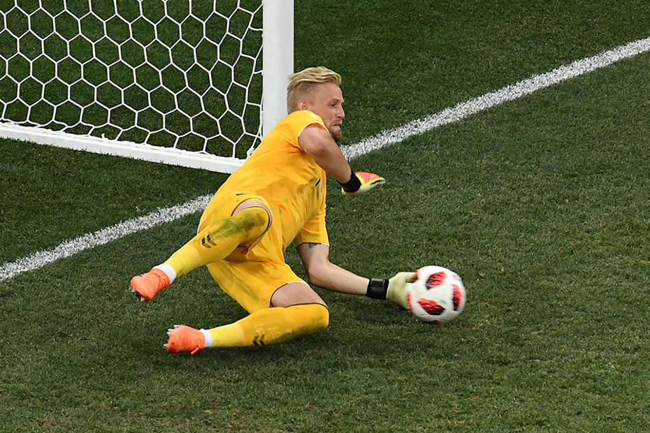 Kasper Schmeichel makes a save during a premier league game.