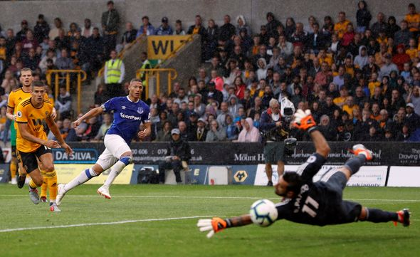 Everton forward Richarlison curls the ball past Wolves goalkeeper Rui Patricio. (Getty Images)
