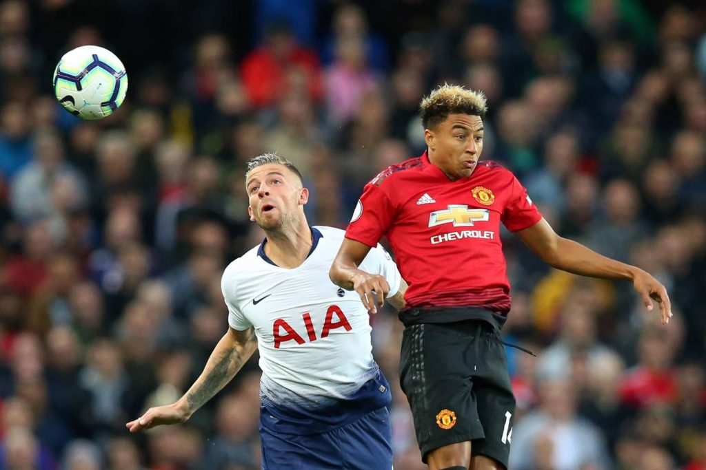 Tottenham's Toby Alderweireld challenges for the ball in the air with Manchester United's Jesse Lingard. (Getty Images)