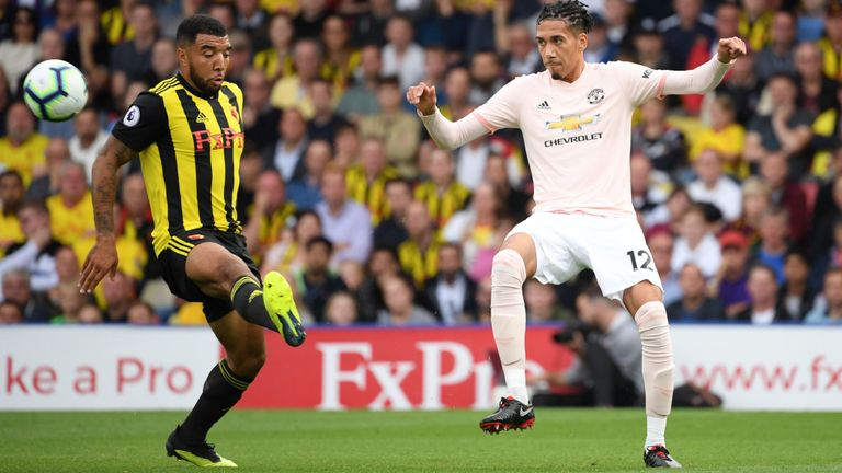 Manchester United defender Chris Smalling tries to block Watford skipper Troy Deeney's shot. (Getty Images)