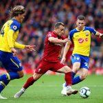 Liverpool's Xherdan Shaqiri dribbles past Southampton players in a Premier League game between Liverpool and Southampton at Anfield. (Getty Images)