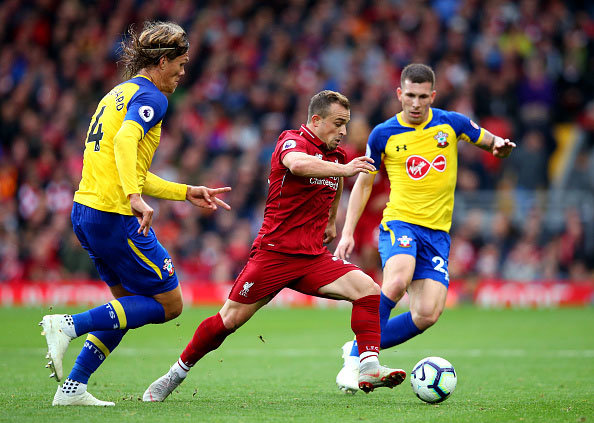 Liverpool's Xherdan Shaqiri dribbles past Southampton players in a Premier League game between Liverpool and Southampton at Anfield. (Getty Images)