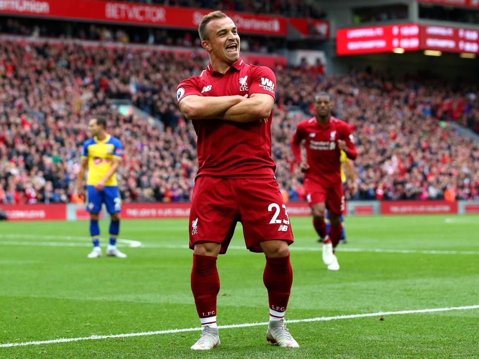 Xherdan Shaqiri celebrates after scoring for Liverpool.