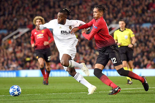 Chris Smalling battles with Valencia's Michy Batshuayi for the ball while playing for Manchester United.
