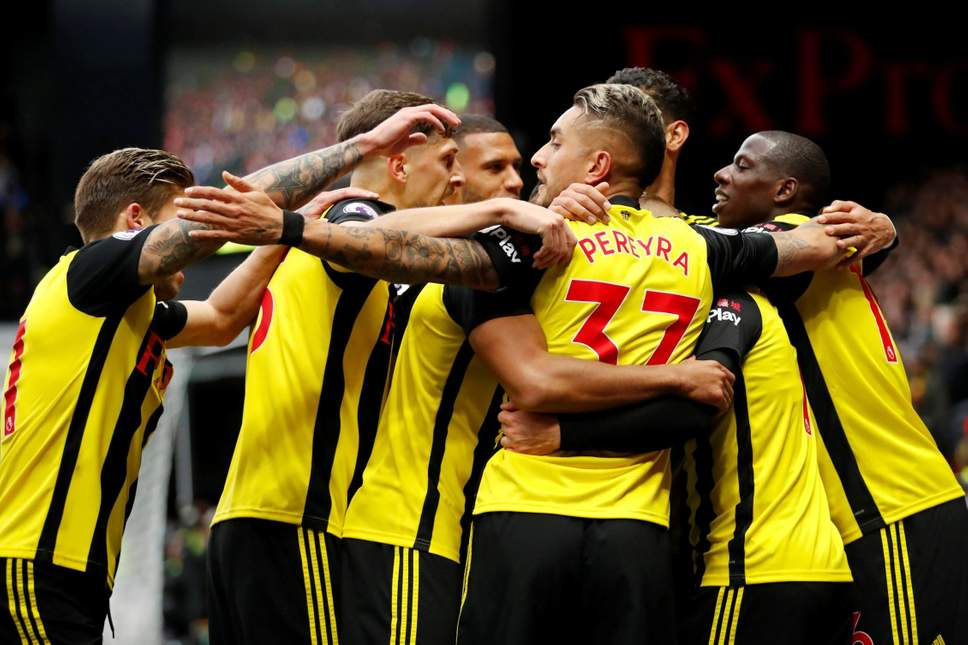 Watford players celebrating during a premier league game.