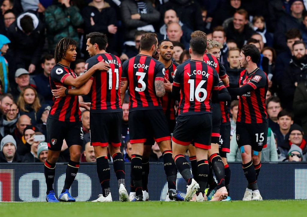 Bournemouth players celebrating after scoring a goal during a premier league encounter.