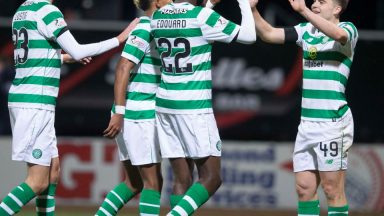 Celtic players celebrate after scoring. (Getty Images)