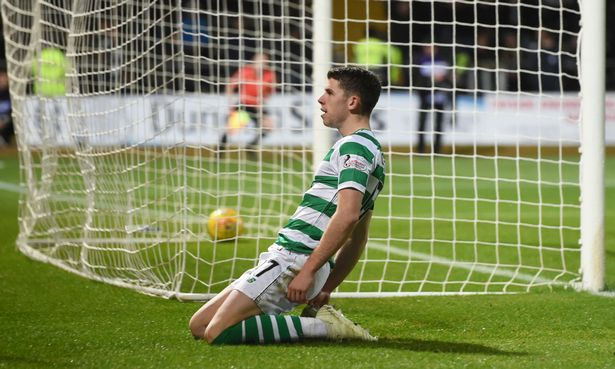 Ryan Christie slides in front of the Celtic fans after scoring. (Getty Images)