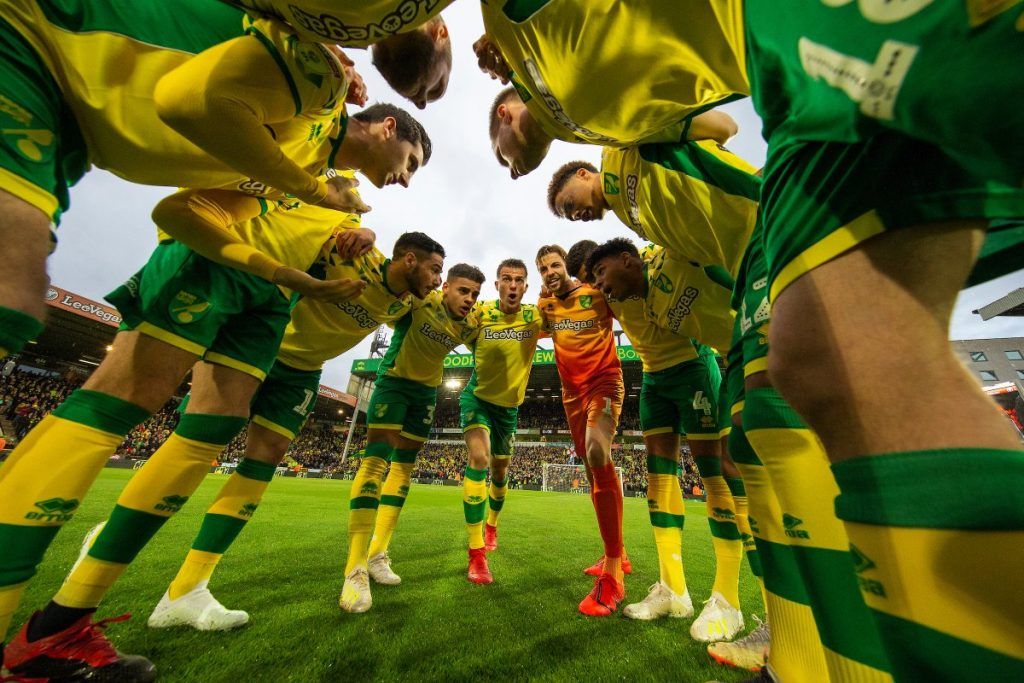 Norwich players gather ahead of a Premier League encounter.