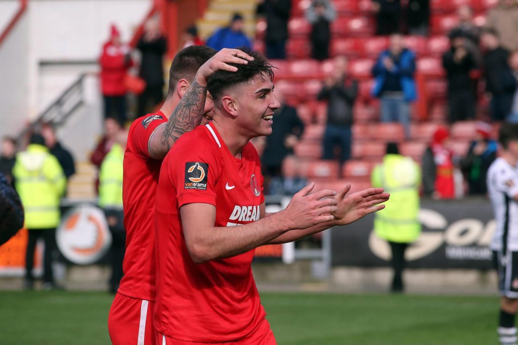Leyton Orient defender Dan Happe celebrates a goal with his teammate. (Getty Images)