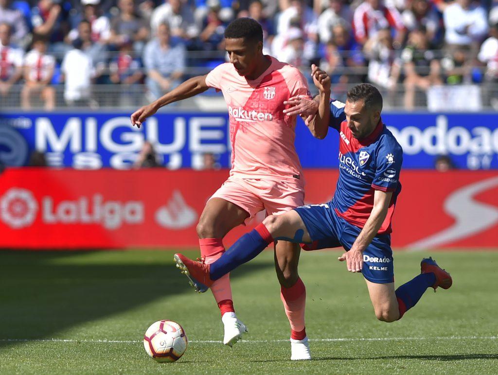 Barcelona's French defender Jean-Clair Todibo (L) vies with SD Huesca's Spanish forward David Ferreiro during the Spanish league football match between SD Huesca and FC Barcelona at the El Alcoraz stadium in Huesca on April 13, 2019. (Getty Images)