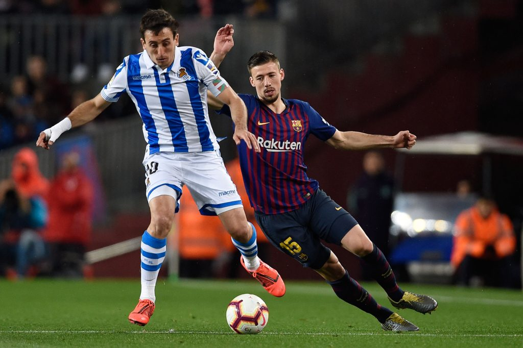 Real Sociedad's Spanish midfielder Mikel Oyarzabal (left) vies with Barcelona's French defender Clement Lenglet during the Spanish league football match.