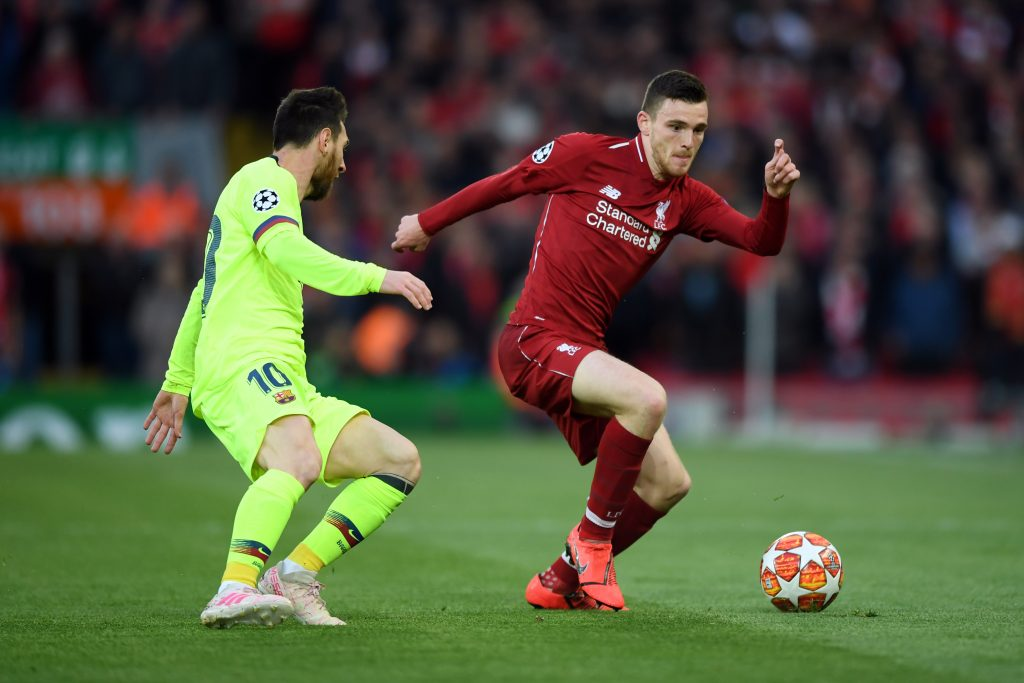 Andy Robertson of Liverpool takes on Lionel Messi of Barcelona during the UEFA Champions League semifinal second leg match in Liverpool, England.