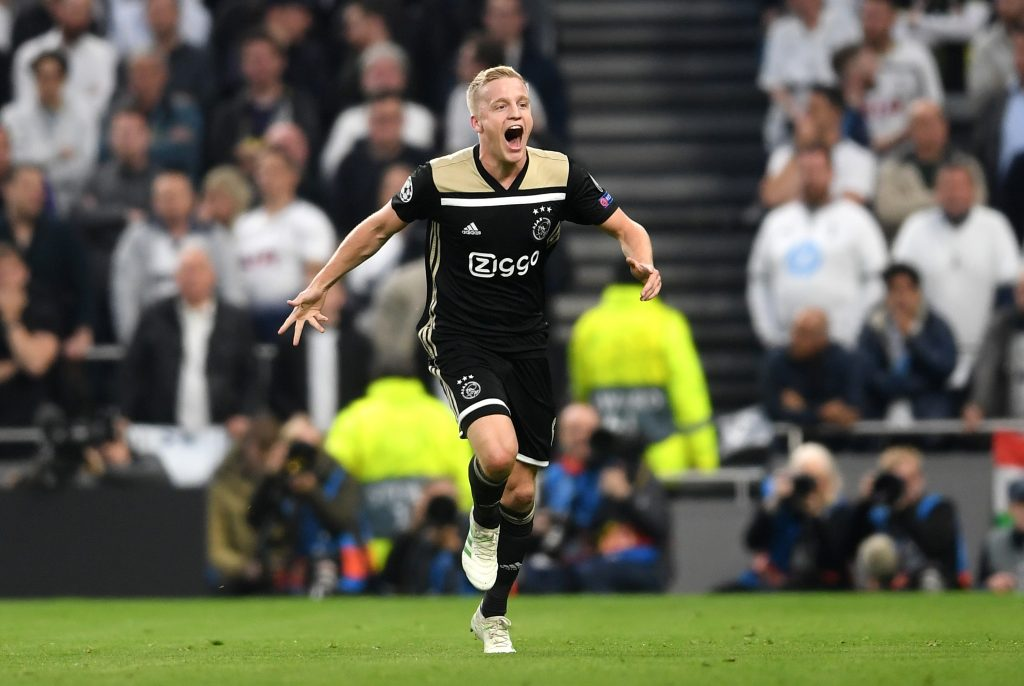 Donny van de Beek of Ajax celebrates as he scores his team's first goal during the UEFA Champions League Semi-Final first leg match against Tottenham Hotspur in London.