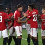 Manchester United players celebrate after scoring. (Getty Images)