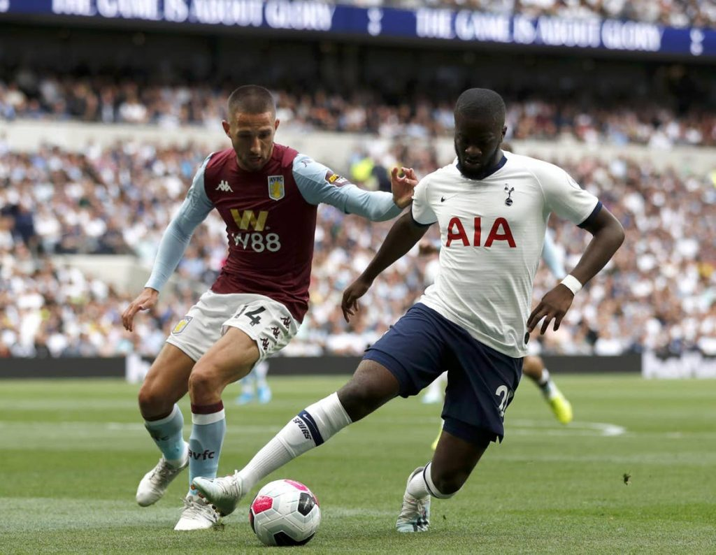 Tottenham midfielder Tanguy NDombele dribbles past Aston Villa's Conor Hourihane. (Getty Images)