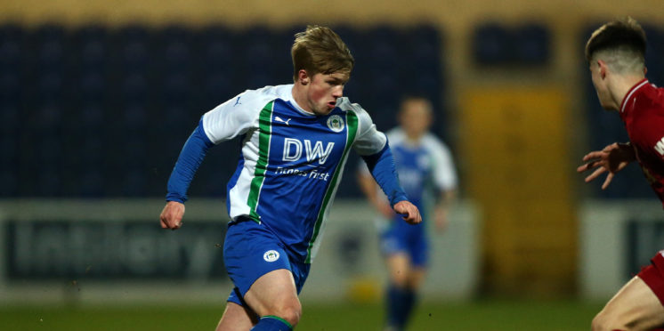 Joe Gelhardt of Wigan Athletic controls the ball during the FA Youth Cup match between Liverpool and Wigan Athletic at Swansway Stadium.
