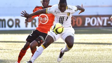 Lille defender Adama Soumaoro shields the ball from his opponent. (Getty Images)