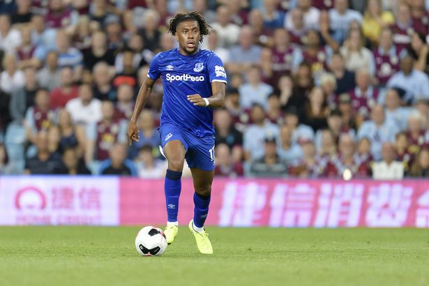 Alex Iwobi running with the ball for Everton.