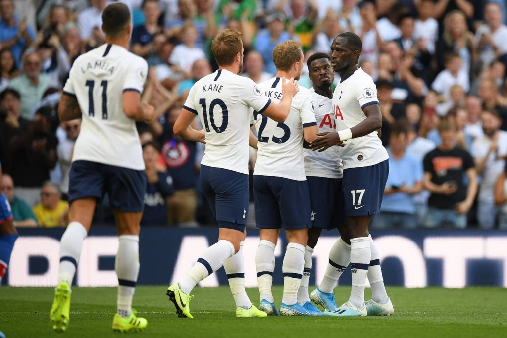 Tottenham players celebrate after scoring a goal.