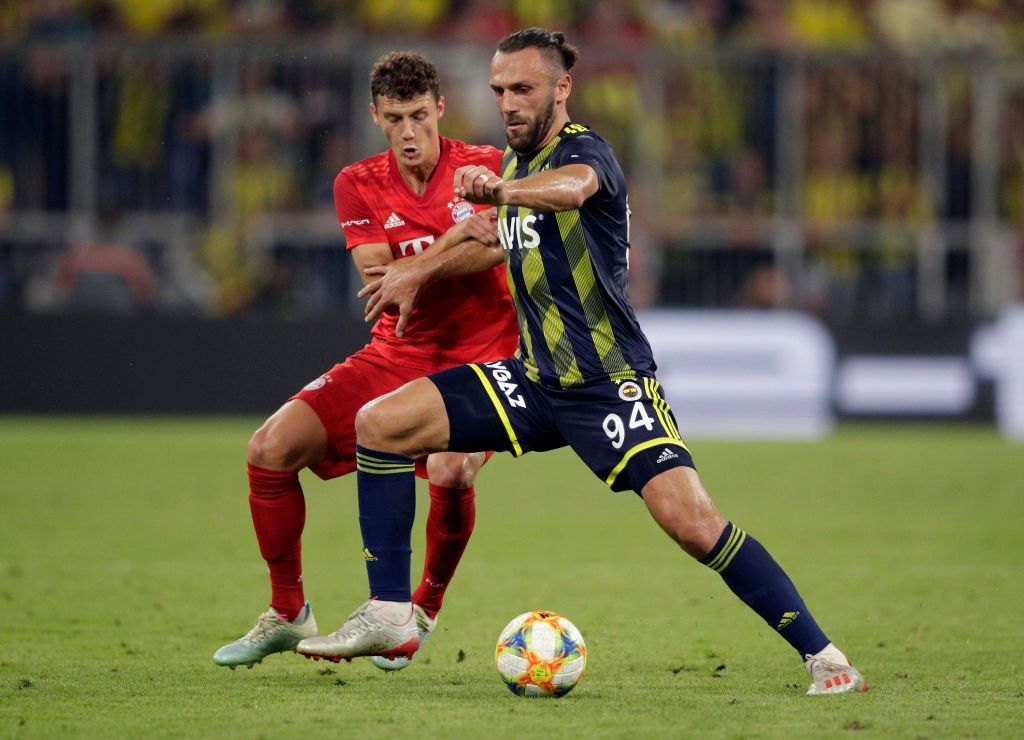 Fenerbahce striker Vedat Muriqi protects the ball from Bayern Munich defender Benjamin Pavard. (Getty Images)