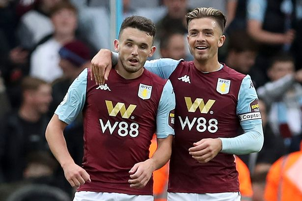 Aston Villa's John McGinn (L) with skipper Jack Grealish (R) in the Premier League. (Getty Images)