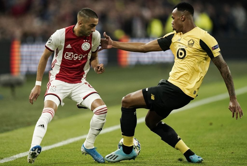 Ajax's Moroccan midfielder Hakim Ziyech fights for the ball with Lille's Brazilian defender Gabriel dos Santos Magalhaes during the UEFA Champions League Group H football match at the Johan Cruijff Arena, in Amsterdam.
